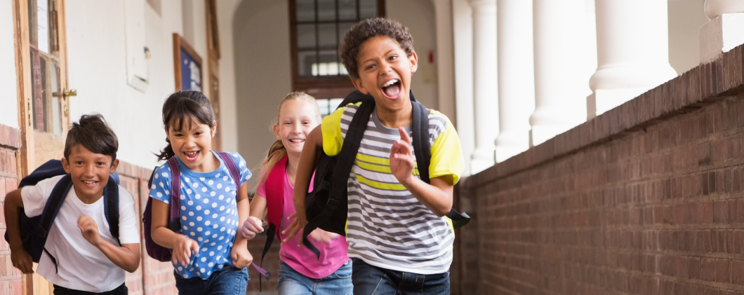 Kids running in the hall of their school