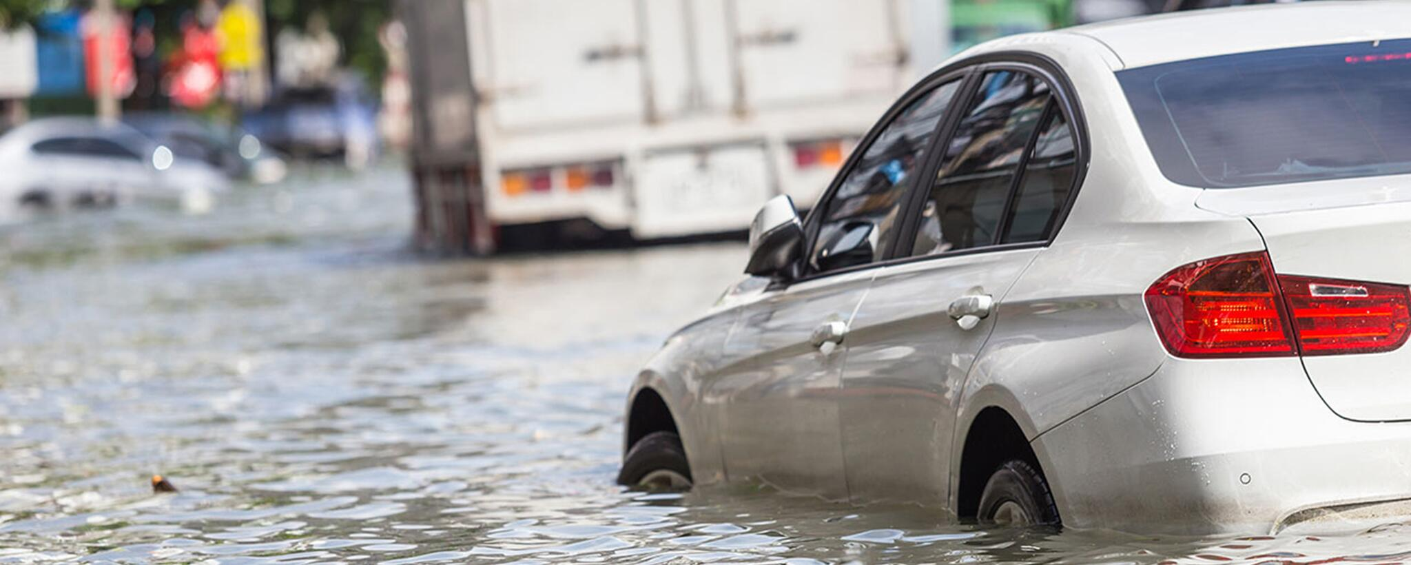 a car floating away in flood water