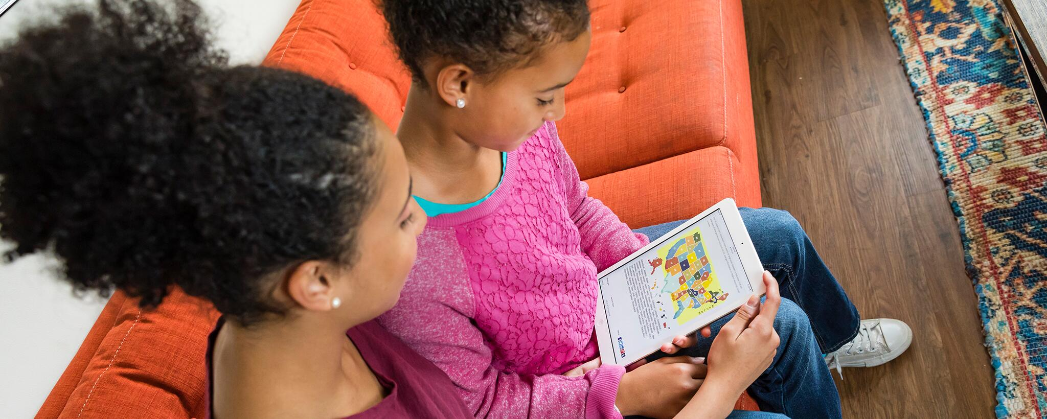 Girls play with tablet