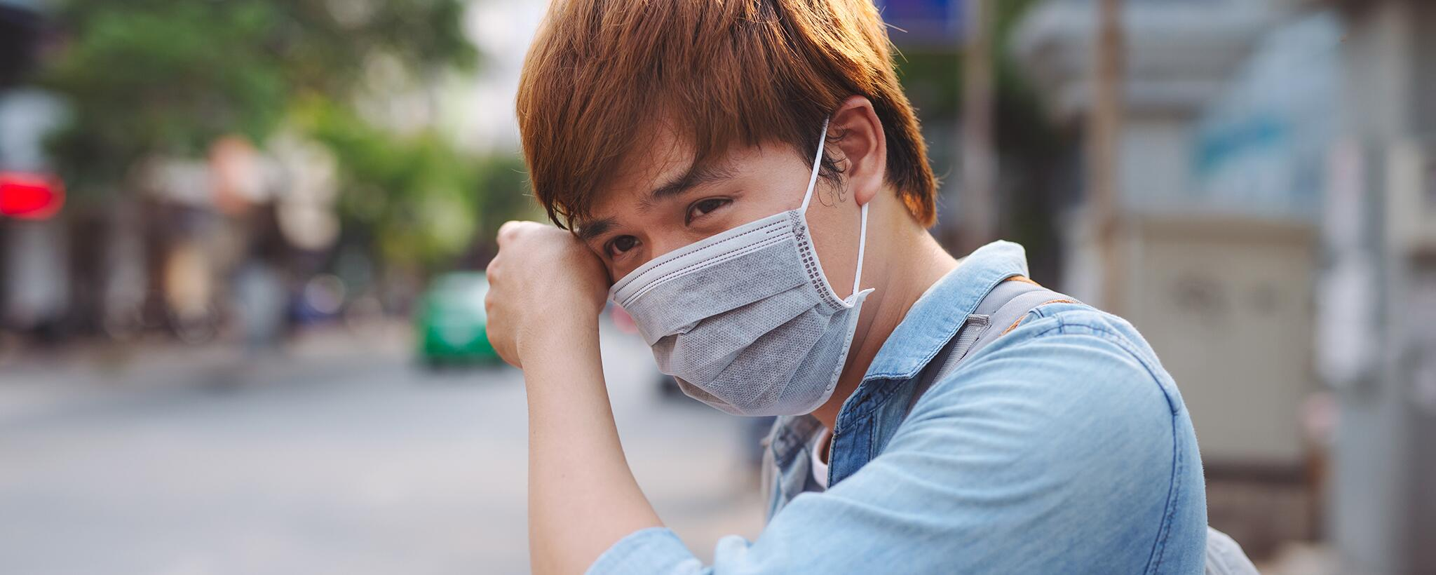 man wearing a face mask to protect from illness