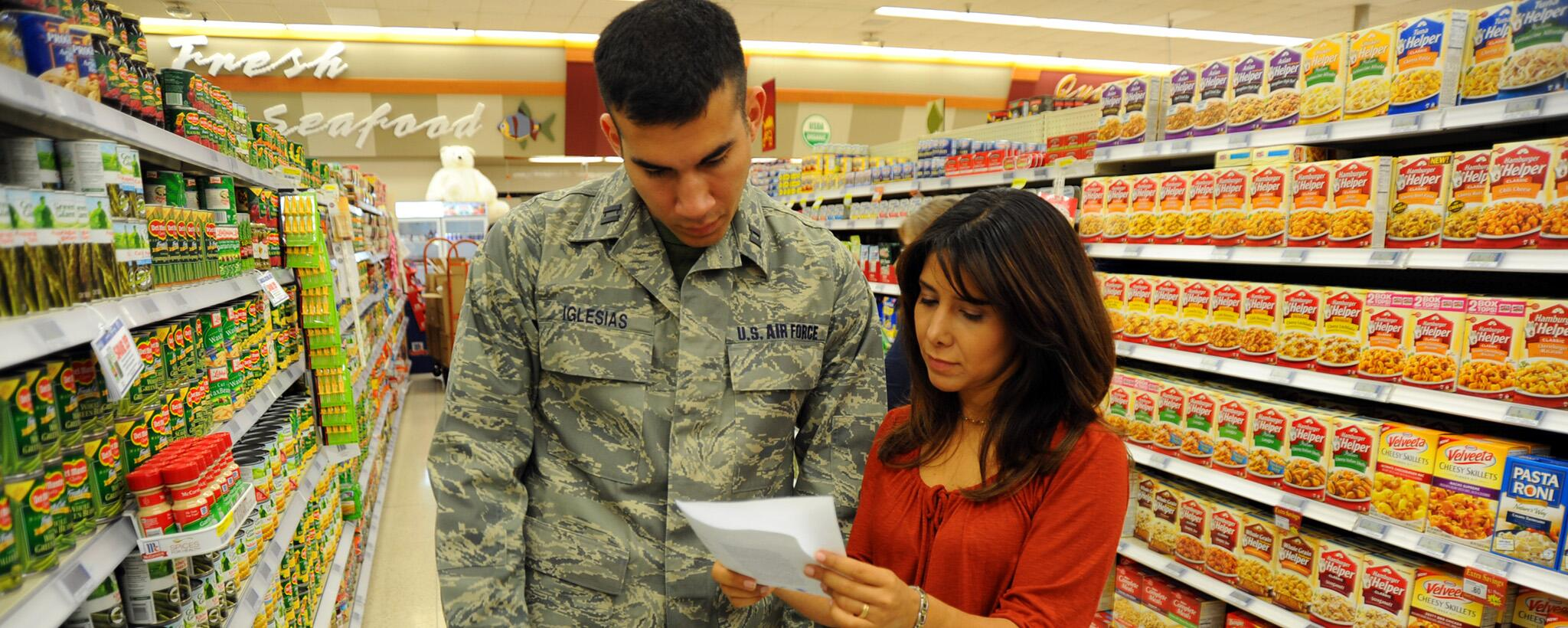 military family shopping for food in grocery store