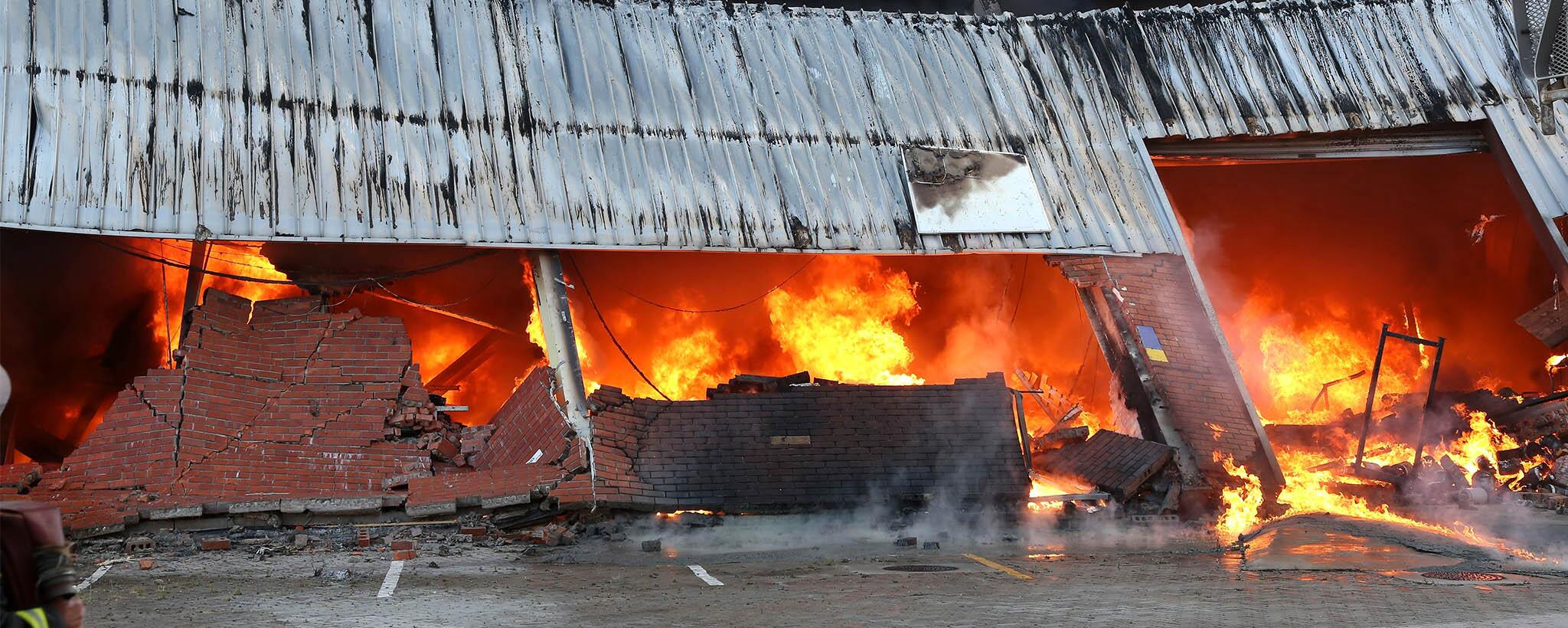 A fire inside of a building has caused the brick exterior and the ceiling to collapse