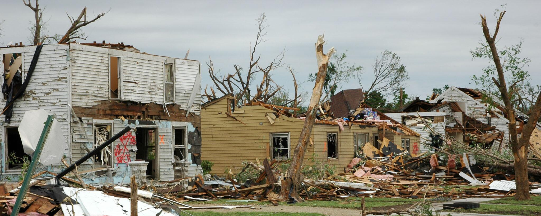 Three houses severely damaged from a tornado.