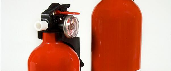 Close up of two fire extinguishers.