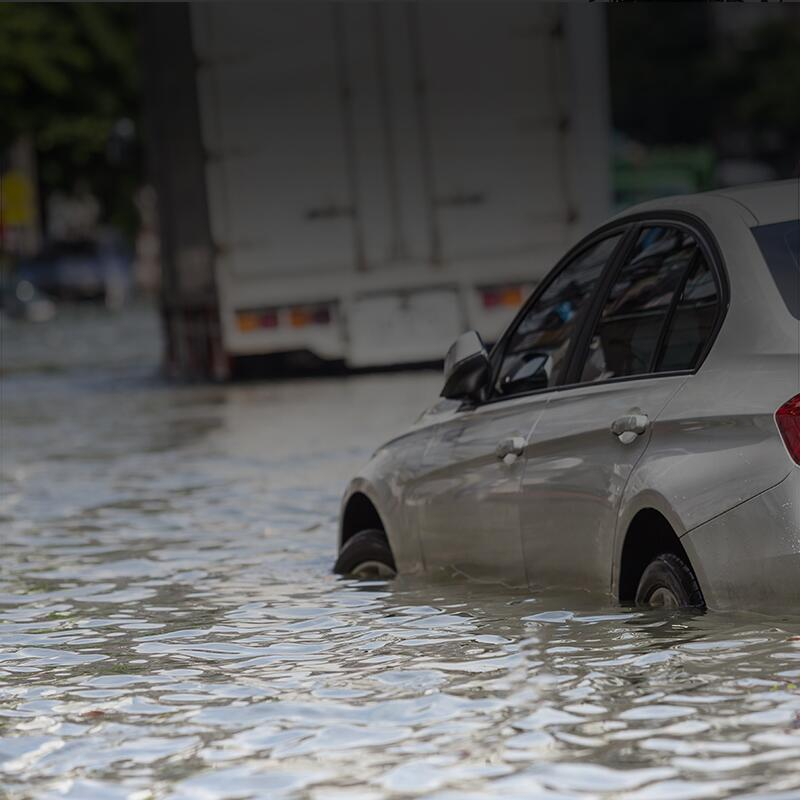 A car floating in several feet of water.