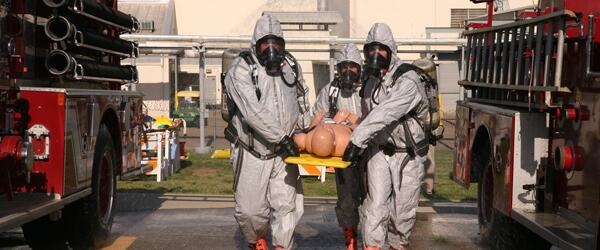 A hazardous materials response team practices life-saving rescue methods