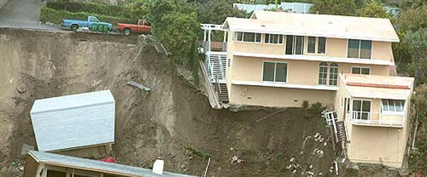 A house destroyed by a landslide.