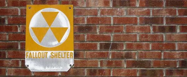 Close up of a Fallout Shelter sign.
