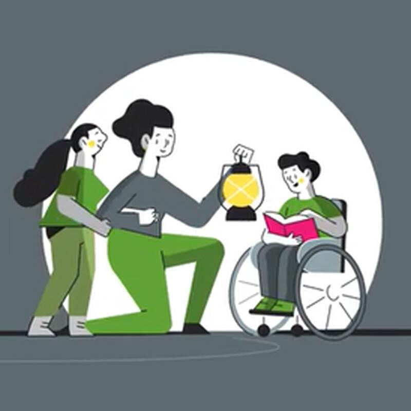 mother holding a lantern with two children, one in a wheelchair