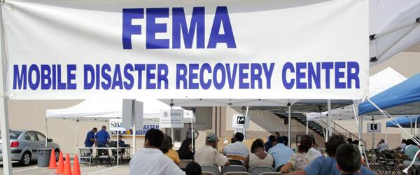 Picture of FEMA Mobile Disaster Recovery Center banner hanging up at a FEMA support site