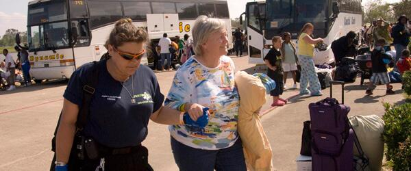 FEMA volunteer helps woman returning home