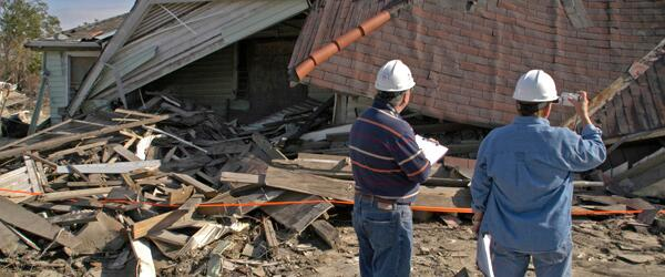 Building inspectors evaluate damaged homes after a disaster.