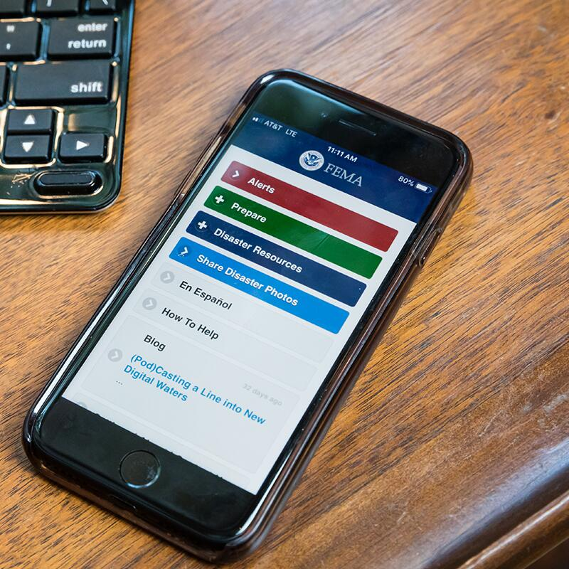 a smart phone open to the FEMA app