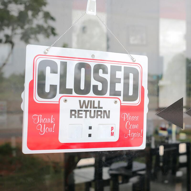 a closed sign in a business storefront