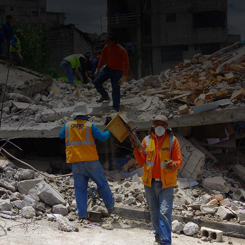 Workers search for earthquake survivors in rubble.