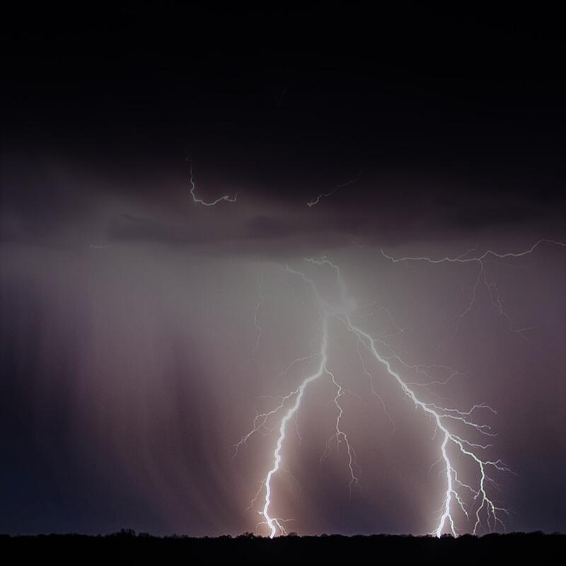 image of llightning striking the ground.