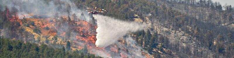 September 6th, 2010. Smoke fills the air as the wildfire is being doused via a fire rescue helicopter.