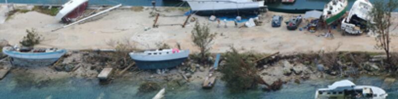 Dec. 8, 2002. The coastline is littered with fishing boats, many thrown on rocks and sand, others sunk in shallow waters.