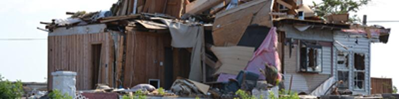 May 22nd, 2011. A single family home lays in shambles as drywall and kitchen cabinets are exposed.