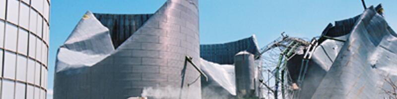 May 22, 2004. Corn is removed from a damaged grain silo.