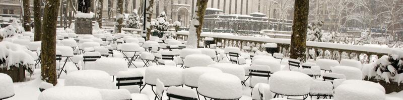 March 13th, 1993. Snow covers coffee tables and chairs in the city.