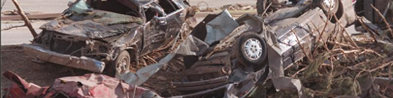 May 3rd, 1999. A pile of cars destroyed from the tornado.