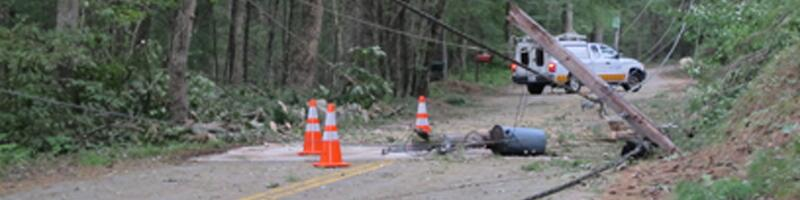 August 28th, 2011. Numerous powerlines are down across a road