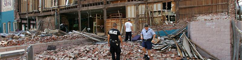 September 24th, 2005. First responders survey the damage to a brick building