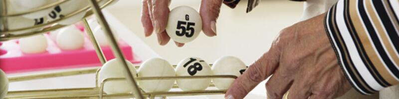 September 17th, 2003. An elderly woman picks up a bingo ball.