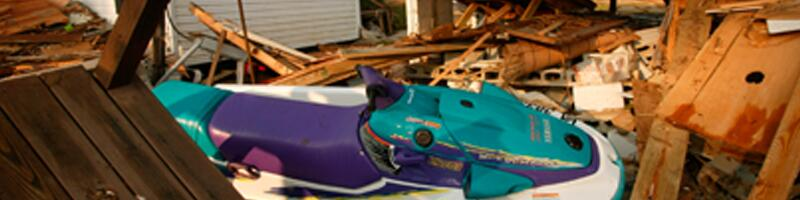 September 18th, 2003. A jet ski sits on top a pile of debris.