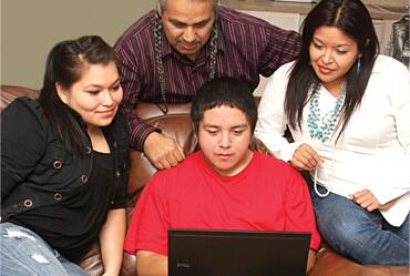 Native American Family Reviewing Online Tips at Ready dot Gov