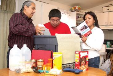 Native American Family Picking items for their Emergency Supply Kit