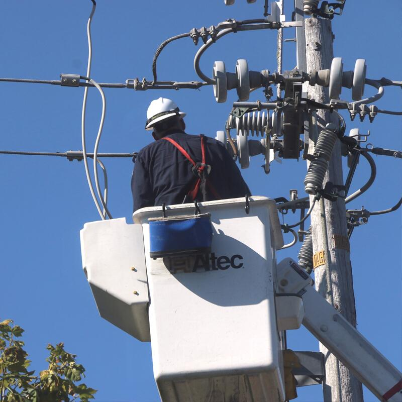 a technician working on power lines