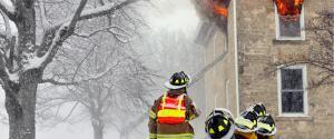 Firefighters battling a home fire