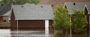 Flood waters rising in a neighborhood of houses