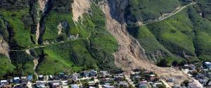 Aerial view of a land slide down a mountain with earth covering