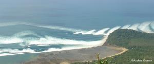 View of tsunami waves hitting a shoreline.