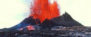 Lava erupting from a volcano's cone.