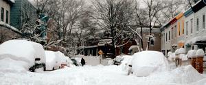 A neighborhood street covered 3 foot deep in snow