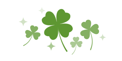 Illustration of several three leaf shamrocks and one four leaf clover in the middle.