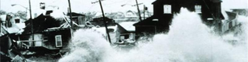 February 6th, 1978. Waves crash into coastal homes due to the blizzard's winds.