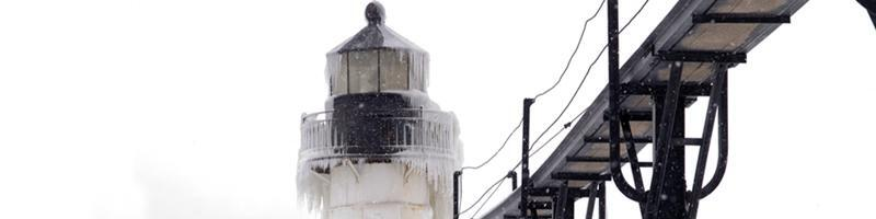 January 10th, 1994. A light house and bridge are completely covered in ice and snow.